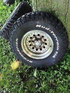 4 Used BF Goodrich Mud Terrain T A KM 31x10 50 R15 Tires with Rims GMC Chev