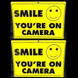 Smile You Are on Video Surveillance Spy Cameras System in Use Warning Signs Lots