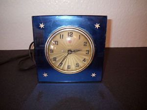 General Electric Art Deco Blue Mirror Glass Clock with Beautiful Star Accents