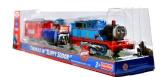 "Fisher Price Year 2009 Thomas and Friends Greatest Moments Series Trackmaster Motorized Railway Battery Powered Tank Engine 3 Pack Train Set   THOMAS in ""SLIPPY SODOR"" with Thomas the Tank Engine, Blue Wagon with Barrel Filled with ""Bubble L"