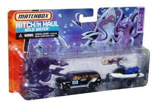 Matchbox Hitch 'N Haul MBX 164 Scale Die Cast Car Playset   Wild Water Set with Black Oceanic Research SUV Chevy Suburban, Jet Ski, Giant Squid, Shark and Scuba Diver Toys & Games